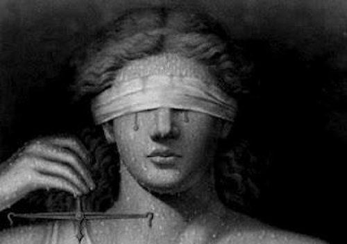 Justiça cega… Ou a cegueira da justiça?